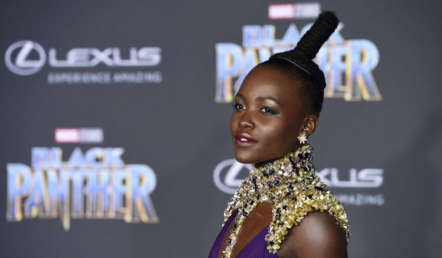 """Lupita Nyong'o, a cast member in """"Black Panther,"""" poses at the premiere of the film at The Dolby Theatre on Monday, Jan. 29, 2018, in Los Angeles. (Photo by Chris Pizzello/Invision/AP)"""