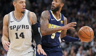 Denver Nuggets' Will Barton (5) drives against San Antonio Spurs' Danny Green during the first half of an NBA basketball game Tuesday, Jan. 30, 2018, in San Antonio. (AP Photo/Darren Abate)