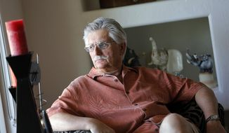 FILE - This May 20, 2014 file photo shows Fred Goldman, father of victim Ron Goldman, in his home in Peoria, Ariz. A lawyer for the family of Fred Goldman says O.J. Simpson is profiting from autographs since his release from prison and should pay the money toward a wrongful death judgment exceeding $70 million. Attorney David Cook plans to ask a Los Angeles Superior Court judge Tuesday, Jan. 30, 2018, to order Simpson to hand over future money he makes autographing sports memorabilia to satisfy the judgment in the wrongful deaths of Ron Goldman and Simpson's ex-wife Nicole Brown Simpson. (AP Photo/Matt York, File)