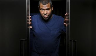 """FILE - In this Feb. 9, 2017 file photo, Jordan Peele poses for a portrait in Los Angeles to promote his directorial debut, """"Get Out."""" Peele received Academy Award nominations for best picture, director and original screenplay. (Photo by Rich Fury/Invision/AP, File)"""