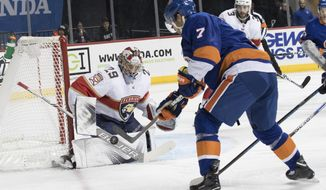 Florida Panthers goaltender Harri Sateri (29) tends the net against New York Islanders center Jordan Eberle (7) during the second period of an NHL hockey game, Tuesday, Jan. 30, 2018 in New York. (AP Photo/Mary Altaffer)