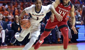 Illinois guard Trent Frazier (1) drives to the basket against Rutgers guard Souf Mensah (44) during the second half of an NCAA college basketball game in Champaign, Ill., Tuesday, Jan. 30, 2018. Illinois won 91-60. (AP Photo/Stephen Haas)