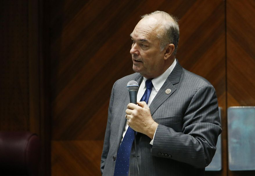 FILE - In this Tuesday, Jan. 9, 2018 file photo, Arizona state Rep. Don Shooter, R-Yuma, reads a statement regarding sexual harassment and other misconduct complaints made against him by Rep. Michelle Ugenti-Rita and others, on the House floor at the Capitol in Phoenix. An internal investigation released Tuesday, Jan. 30, 2018, found that Shooter violated the chamber's sexual harassment policies and has been permanently removed from all committee assignments. (AP Photo/Ross D. Franklin, File)