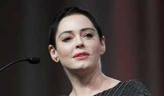 "In this Oct. 27, 2017, file photo, actress Rose McGowan speaks at the inaugural Women's Convention in Detroit. A lawyer for Harvey Weinstein called actress McGowan's claims of rape against the former Hollywood producer are ""a bold lie."" McGowan details her allegations against Weinstein in her new book ""Brave,"" released Tuesday, Jan. 30, 2018. (AP Photo/Paul Sancya, File)"
