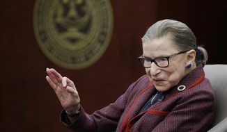 """Supreme Court Justice Ruth Bader Ginsburg answers a law student's question as she participates in a """"fireside chat"""" in the Bruce M. Selya Appellate Courtroom at the Roger William University Law School on Tuesday, Jan. 30, 2018, in Bristol, R.I. (AP Photo/Stephan Savoia) ** FILE **"""