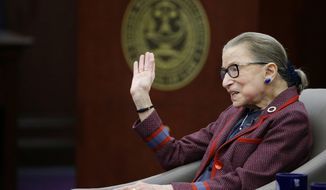 "Supreme Court Justice Ruth Bader Ginsburg waves goodbye to those who came to listen and participate in her ""fireside chat"" in the Bruce M. Selya Appellate Courtroom at the Roger William University Law School on Tuesday, Jan. 30, 2018, in Bristol, R.I. (AP Photo/Stephan Savoia)"