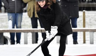 Britain's Kate, Duchess of Cambridge tries a shot with a bandy stick in Stockholm, Sweden, Tuesday Jan. 30, 2017, during Prince William and Duchess of Cambridge 4-day visit to Sweden and Norway. (Jonas Ekstromer/TT via AP)