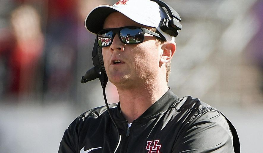 FILE - In this Nov. 24, 2017, file photo, Houston head coach Major Applewhite watches from the sidelines during the first half of an NCAA college football game against Navy in Houston. A lawsuit by former Texas women's track coach Bev Kearney against the school is probing how administrators in the offices that investigate campus sexual misconduct handled former football assistant Major Applewhite's 2009 relationship with a student trainer. (AP Photo/Eric Christian Smith, File)