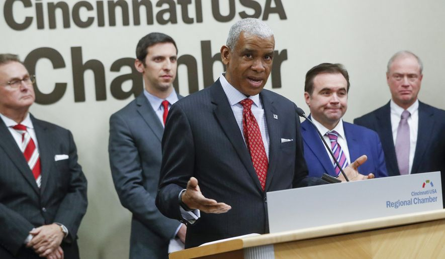Dwight Ferrell, CEO and general manager of the Southwest Ohio Regional Transit Authority (SORTA), speaks during a news conference, Tuesday, Jan. 30, 2018, in Cincinnati. The ride-sharing company Uber is going to do some data-sharing with Cincinnati area public transit agencies and other local authorities in a new approach to the region's transportation issues.  The San Francisco-based global company announced a partnership Tuesday to create the Cincinnati Mobility Lab. Uber will share its transportation data platform and launch studies of such issues as curbside congestion and the bus services in the Cincinnati-northern Kentucky region.(AP Photo/John Minchillo)
