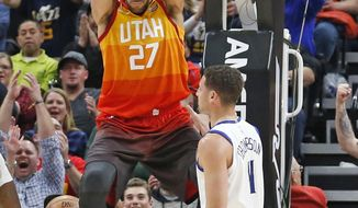 Utah Jazz center Rudy Gobert (27) dunks the ball as Golden State Warriors guard Klay Thompson (11) looks on in the first half during an NBA basketball game Tuesday, Jan. 30, 2018, in Salt Lake City. (AP Photo/Rick Bowmer)