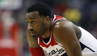 FILE - In this Jan. 10, 2018, file photo, Washington Wizards guard John Wall (2) pauses on the court during the second half of an NBA basketball game against the Utah Jazz in Washington. Wall will have arthroscopic surgery on his left knee on Wednesday and could miss much of the rest of the regular season, the Wizards announced Tuesday, Jan. 30, 2018. (AP Photo/Alex Brandon, File) **FILE**