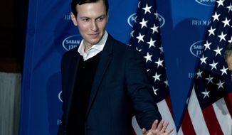 President Donald Trump's White House Senior Adviser Jared Kushner waves to the audience after speaking at the Saban Forum in Washington, Sunday, Dec. 3, 2017. (AP Photo/Jose Luis Magana)