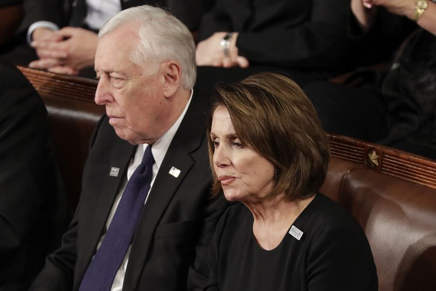 House Minority Leader Nancy Pelosi of California and Minority Whip Steny Hoyer, D-Md., listen to the State of the Union address to a joint session of Congress on Capitol Hill in Washington, Tuesday, Jan. 30, 2018. (AP Photo/J. Scott Applewhite) **FILE**