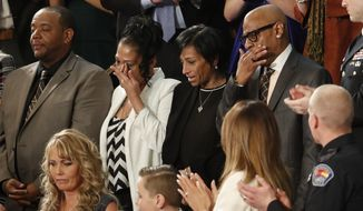 From top left, Robert Mickens, Elizabeth Alvarado, Evelyn Rodriguez, Freddy Cuevas, parents of two Long Island teenagers who were believed to have been killed by MS-13 gang members, during the State of the Union address to a joint session of Congress on Capitol Hill in Washington, Tuesday, Jan. 30, 2018. (AP Photo/Pablo Martinez Monsivais) ** FILE **
