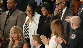 From top left, Robert Mickens, Elizabeth Alvarado, Evelyn Rodriguez, Freddy Cuevas, parents of two Long Island teenagers who were believed to have been killed by MS-13 gang members, during the State of the Union address to a joint session of Congress on Capitol Hill in Washington, Tuesday, Jan. 30, 2018. (AP Photo/Pablo Martinez Monsivais)