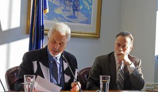 Alaska Senate President Pete Kelly, left, speaks during a committee meeting while Senate Majority Leader Peter Micciche looks on, Wednesday, Jan. 31, 2018, in Juneau, Alaska. During the meeting, a report by the Legislature's human resources manager was released that found Wasilla Republican Sen. David Wilson had engaged in retaliation. Wilson said he was not interviewed as part of the review but will respect the wishes of his leadership, who disciplined him. (AP Photo/Becky Bohrer)