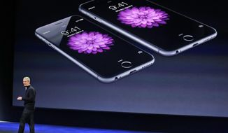 FILE - In this March 9, 2015 file photo, Apple CEO Tim Cook talks about the iPhone 6 and iPhone 6 Plus during an Apple event in San Francisco. U.S. authorities are investigating Apple's slowing of older iPhones, according to published reports. The Wall Street Journal and Bloomberg reported Tuesday, Jan. 30, 2018, that the Department of Justice and the Securities and Exchange Commission are probing whether Apple violated securities laws. (AP Photo/Eric Risberg, File)