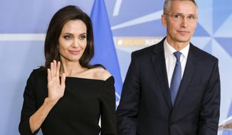 NATO Secretary General Jens Stoltenberg, right, and the Special Envoy for the United Nations High Commissioner for Refugees Angelina Jolie leave after a media briefing at NATO headquarters in Brussels,  Wednesday, Jan. 31, 2018. (AP Photo/Geert Vanden Wijngaert)