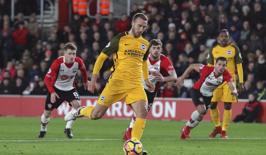 Brighton & Hove Albion's Glenn Murray scores his side's first goal of the game from the penalty spot during their English Premier League soccer match against Southampton at St Mary's, Southampton, England, Wednesday, Jan. 31, 2018. (Andrew Matthews/PA via AP)