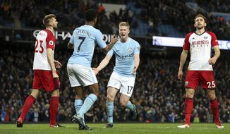 Manchester City's Kevin De Bruyne, right, celebrates with Raheem Sterling after scoring his side's second goal during the English Premier League soccer match Manchester City versus West Bromwich Albion at The Etihad Stadium, Manchester, England, Wednesday Jan. 31, 2018. (Martin Rickett/PA via AP)