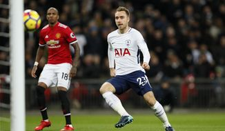 Tottenham's Christian Eriksen, right, scores the opening goal during the English Premier League soccer match between Tottenham Hotspur and Manchester United at Wembley stadium in London, England, Wednesday, Jan. 31, 2018. (AP Photo/Kirsty Wigglesworth)