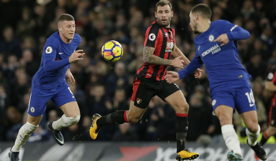 Chelsea's Ross Barkley, left, chases the ball as Chelsea's Eden Hazard, right, and Bournemouth's Steve Cook look on during the English Premier League soccer match between Chelsea and Bournemouth at Stamford Bridge in London, Wednesday Jan. 31, 2018. (AP Photo/Tim Ireland)