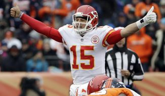 FILE- In this Dec. 31, 2017, file photo, Kansas City Chiefs quarterback Patrick Mahomes (15) signals against the Denver Broncos during the first half of an NFL football game in Denver. The countdown to the Mahomes era in Kansas City is down to six weeks, with no apparent caveats. The Chiefs' trade of Alex Smith to Washington becomes official in March, but already the Chiefs are preparing for life under a new QB. (AP Photo/Joe Mahoney, File)
