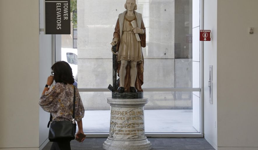 In this photo taken Aug. 23, 2017, a statue of explorer, Christopher Columbus, stands in the lobby of San Jose City Hall in San Jose, Calif. Leaders of Silicon Valley's largest city voted Tuesday, Jan. 30, 2018, to remove the statue of Columbus. The Mercury News reports that the Italian American community has six weeks to find the statue a new home or else it will be put in storage. (Patrick Tehan/Bay Area News Group via AP)
