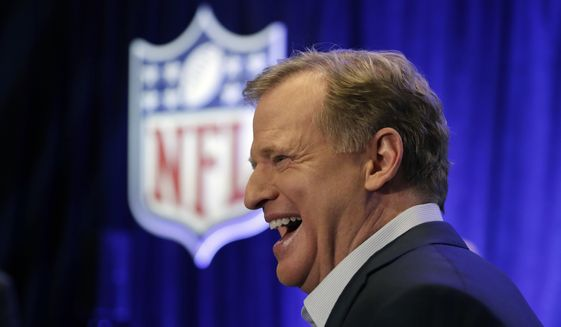 NFL Commissioner Roger Goodell laughs after talking with former head coach Tony Dungy before a news conference in advance of the Super Bowl 52 football game, Wednesday, Jan. 31, 2018, in Minneapolis. The Philadelphia Eagles play the New England Patriots on Sunday, Feb. 4, 2018. (AP Photo/Matt Slocum)