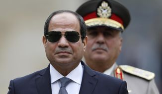 FILE - In this Oct. 24, 2017 file photo, Egyptian President Abdel-Fattah el-Sissi attends a military ceremony in the courtyard at the Hotel des Invalides in Paris, France. On Wednesday, Jan. 31, 2018, a clearly furious el-Sissi gave a thinly veiled but stern warning to opposition politicians calling for a boycott of presidential elections in March, saying he would die first before allowing anyone to mess with the country's security. El-Sissi spoke a day after a coalition of opposition parties and public figures  described the vote as a farce. (Charles Platiau, Pool via AP, File)