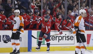 Washington Capitals center Chandler Stephenson (18) celebrates his goal with his teammates, with Philadelphia Flyers defensemen Brandon Manning (23) and Ivan Provorov (9), from Russia, nearby during the second period of an NHL hockey game Wednesday, Jan. 31, 2018, in Washington. (AP Photo/Alex Brandon)