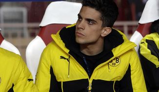 """FILE - In this Wednesday April 19, 2017 file photo, Dortmund's Marc Bartra sits on the bench before their Champions League quarterfinal second leg soccer match against Monaco at the Louis II stadium in Monaco. Spanish defender Marc Bartra is leaving Borussia Dortmund to join La Liga side Real Betis. Dortmund says it has made a """"big concession"""" on the transfer fee to allow Bartra return to Spain after what has been a tumultuous one and half Bundesliga seasons. (AP Photo/Claude Paris, file)"""