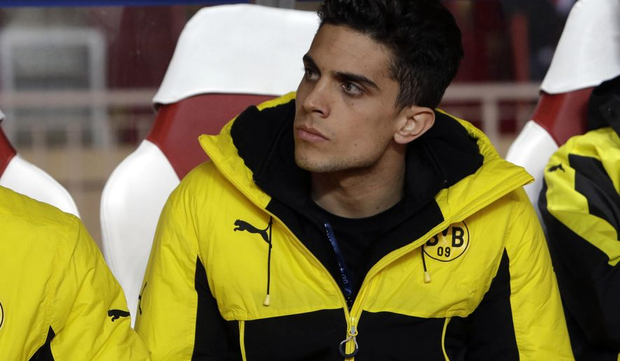 "FILE - In this Wednesday April 19, 2017 file photo, Dortmund's Marc Bartra sits on the bench before their Champions League quarterfinal second leg soccer match against Monaco at the Louis II stadium in Monaco. Spanish defender Marc Bartra is leaving Borussia Dortmund to join La Liga side Real Betis. Dortmund says it has made a ""big concession"" on the transfer fee to allow Bartra return to Spain after what has been a tumultuous one and half Bundesliga seasons. (AP Photo/Claude Paris, file)"