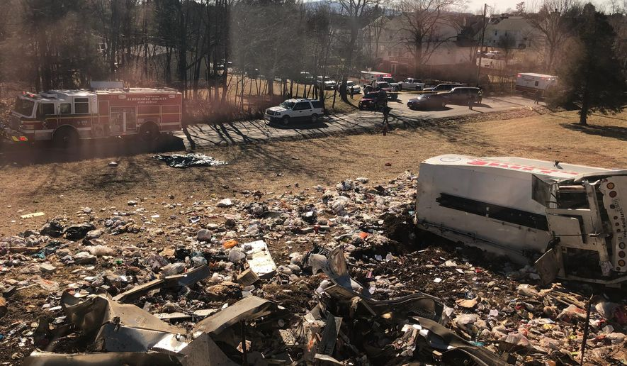 This photo provided by a member of Congress, shows a crash site near Crozet, Va., Wednesday, Jan. 31, 2018.   A chartered train carrying dozens of GOP lawmakers to a Republican retreat in West Virginia struck a garbage truck south of Charlottesville, Virginia on Wednesday, lawmakers said. (AP Photo)