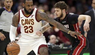 Cleveland Cavaliers' LeBron James drives past Miami Heat's Tyler Johnson in the second half of an NBA basketball game, Wednesday, Jan. 31, 2018, in Cleveland. The Cavaliers won 91-89. (AP Photo/Tony Dejak)
