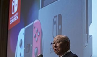 "Japanese video game maker Nintendo Co. President Tatsumi Kimishima speaks in front of picture of the Nintendo Switch gaming console during a news conference during in Tokyo Thursday, Feb. 1, 2018. Japanese video-game company Nintendo Co. says a movie starring the plumber in the Super Mario franchise is in the works, being co-produced with Chris Meledandri, the chief executive of Illumination Entertainment, the U.S. animation studio behind the popular ""Despicable Me"" series. (AP Photo/Eugene Hoshiko)"