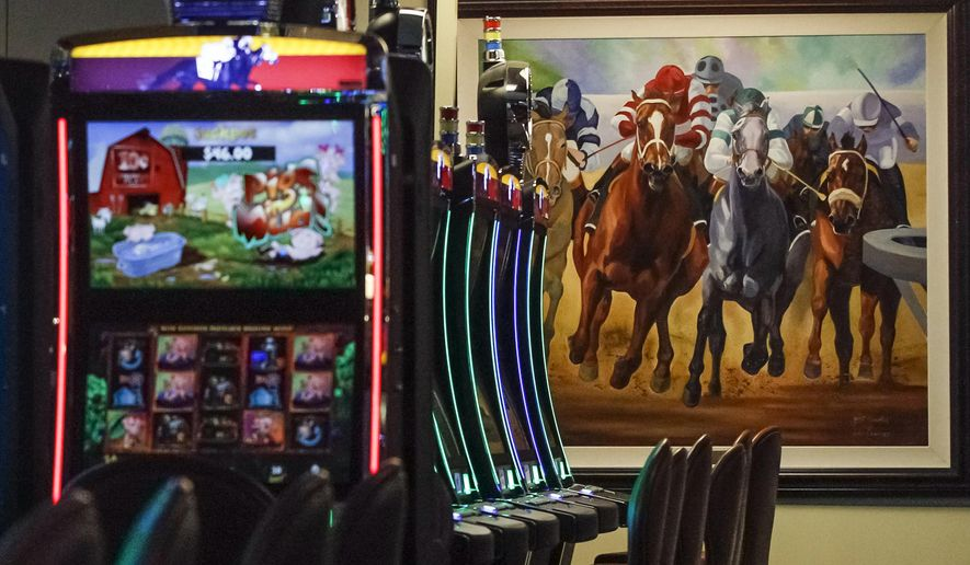 FILE - This March 5, 2015, file photo shows video gaming terminals known as instant horse racing at Les Bois Park in Garden City, Idaho. Such machines are now banned in Idaho, but a new ballot initiative has been filed to legalize the machines. (AP Photo/Otto Kitsinger, File)