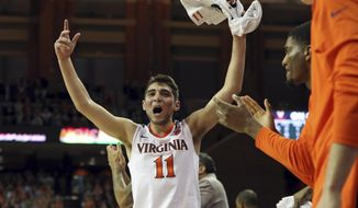 Virginia guard Ty Jerome (11) celebrates a basket during an NCAA college basketball game against Louisville, Wednesday, Jan. 31, 2018, in Charlottesville, Va. (AP Photo/Andrew Shurtleff) ** FILE **