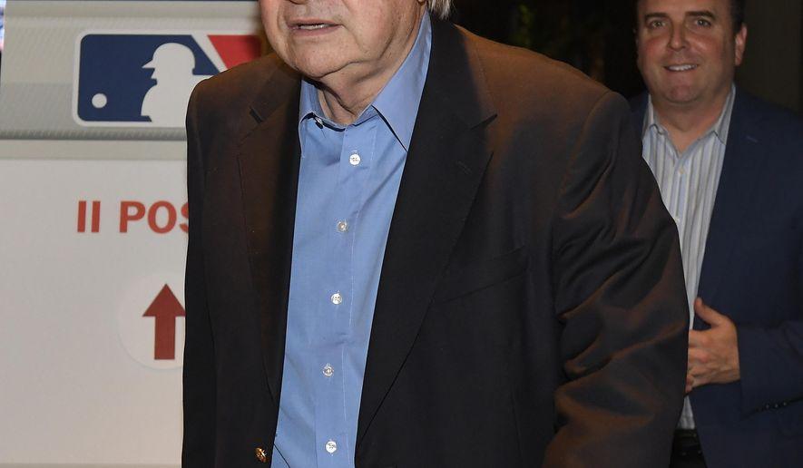 Arizona Diamondbacks owner Ken Kendrick is followed by Derrick Hall, president and CEO of the Diamondbacks, as they leave a gathering during Major League Baseball owners meetings Wednesday, Jan. 31, 2018, in Los Angeles. (AP Photo/Mark J. Terrill)