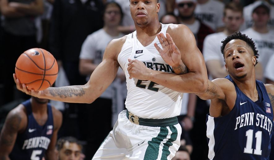 Penn State's Lamar Stevens, right, reaches in against Michigan State's Miles Bridges during the first half of an NCAA college basketball game, Wednesday, Jan. 31, 2018, in East Lansing, Mich. (AP Photo/Al Goldis)