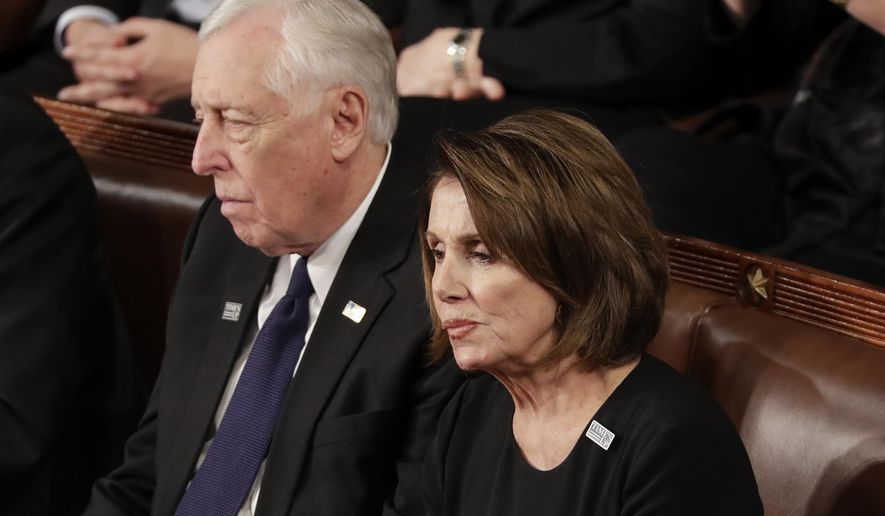 House Minority Leader Nancy Pelosi of California and Minority Whip Steny Hoyer, D-Md., listen to the State of the Union address to a joint session of Congress on Capitol Hill in Washington, Tuesday, Jan. 30, 2018. (AP Photo/J. Scott Applewhite)