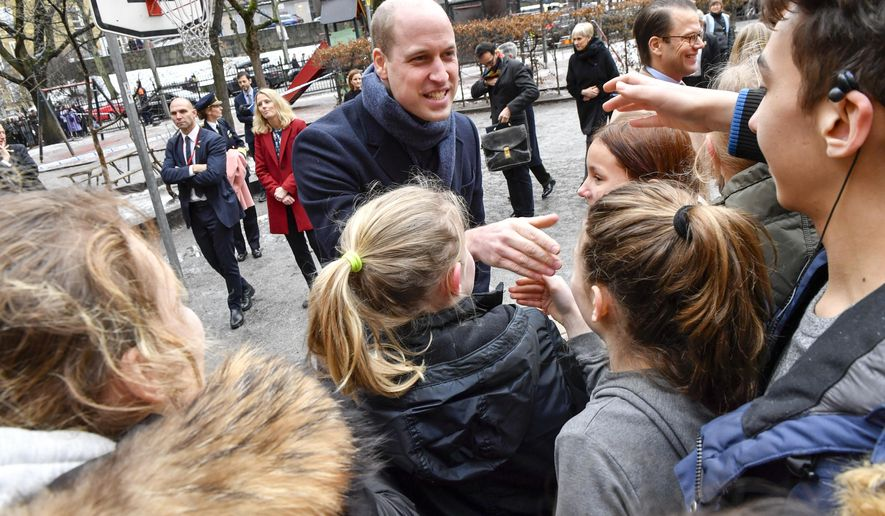 Britain's Prince William is greeted by pupils at Matteus School in Stockholm, Sweden, Wednesday Jan. 31, 2018.  Prince William and Kate Duchess of Cambridge are on a four-day visit to Sweden and Norway. (Jonas Ekströmer / TT via AP)