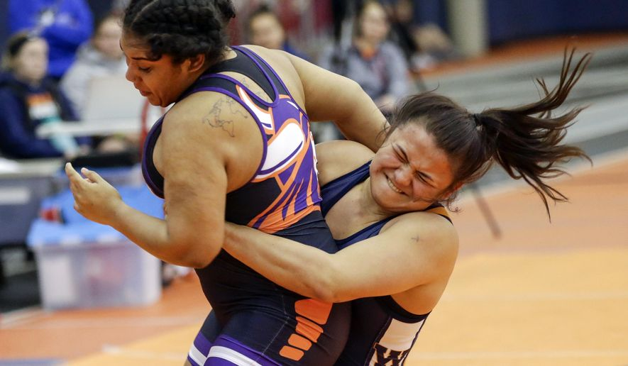 In this Jan. 27, 2018 photo, Midland University's Leilani Camargo-Naone, right, wrestles Missouri Valley College's Alyssa Cantu during a bout at the Kansas Collegiate Athletic Conference championships in Fremont, Neb. Leilani Camargo-Naone represents Midland's best chance for a national title. The sophomore from Wai'anae, on the west side of Oahu, is ranked No. 4 in the nation at 191 and was the only Midland wrestler to win a conference championship. She's 61-9 with 40 pins in her career. (AP Photo/Nati Harnik)