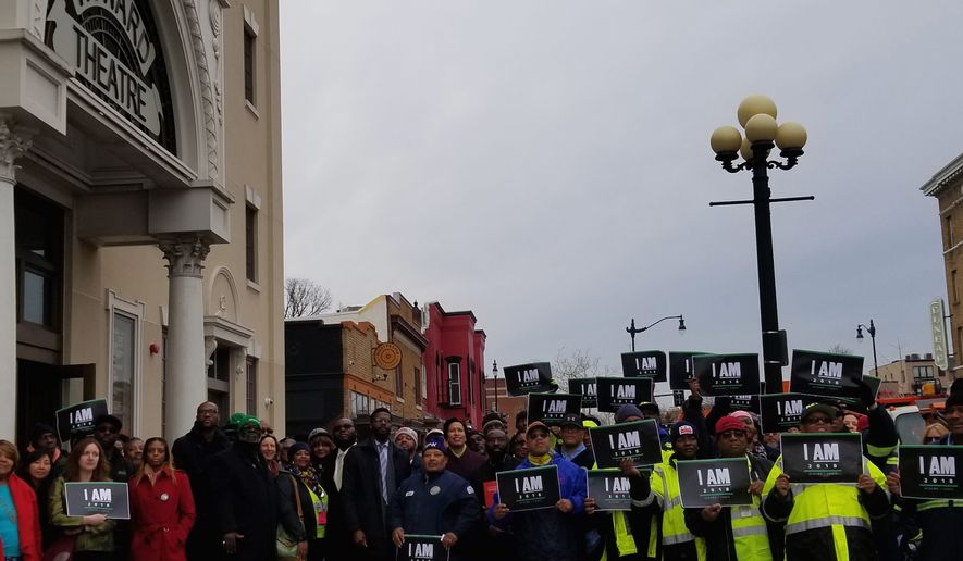Mayor Bowser (center), a Democrat, leads a commemoration of the 1968 sanitation workers strike in Memphis outside Howard Theatre in Shaw on February 1st, 2018. Joining the mayor is D.C. Congresswoman Eleanor Norton (not pictured) and Francis Synder (second from the right), a D.C. street sweeper of 20 years and member of the American Federation of State, County and Municipal Employees. ( (Photographs by Julia Airey/The Washington Times)