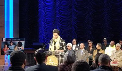 """Mayor Muriel Bowser (center), a Democrat unveils her """"Fair Shot"""" program to guide more African American residents and businesses into the middle class during an event at Howard Theatre in Shaw on February 1st, 2018. The collection of D.C. governments resources is also a jump start to her re-election bid for the mayor's office. (Julia Airey / The Washington Times)"""