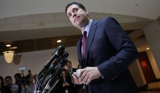 "In this photo taken Wednesday, March 22, 2017, House Intelligence Committee Chairman Devin Nunes, R-Calif., gives reporters an update about the ongoing Russia investigation adding that President Donald Trump's campaign communications may have been ""monitored"" during the transition period as part of an ""incidental collection,"" on Capitol Hill in Washington. (AP Photo/J. Scott Applewhite) ** FILE **"