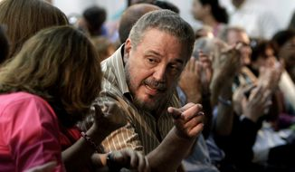 """FILE - In this March 14, 2012 file photo, Fidel Castro Diaz-Balart, son of then Cuban leader Fidel Castro, speaks with an unidentified woman during the presentation of his father's book """"Nuestro Deber es Luchar,"""" or """"Our Duty is to Fight,"""" in Havana, Cuba. According to Cuban state media on Feb. 1, 2018, Diaz-Balart has killed himself. (AP Photo/Franklin Reyes, File)"""