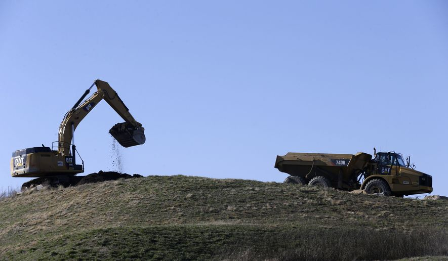 In this Thursday, Jan. 14, 2016, photo, coal ash is removed from the Dan River Steam Station in Eden, N.C., to be transported by rail to a permanent site in Virginia.  (AP Photo/Gerry Broome)