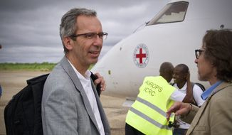 International Committee of the Red Cross director of operations Dominik Stillhart and Somalia's head of delegation, Jordi Raich, arrive in Baidoa, Somlia in this photo by Abdikarim Mohamed for ICRC.  [https://avarchives.icrc.org/Picture/135779]