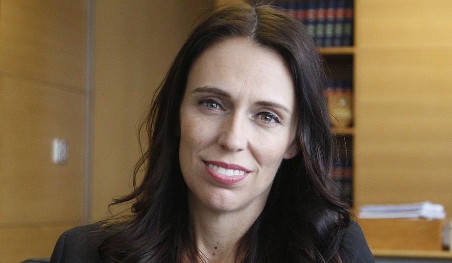 """New Zealand Prime Minister Jacinda Ardern poses for a photo on Thursday, Feb. 1, 2018, in Wellington, New Zealand. Ardern told The Associated Press in an interview she supports sanctions against North Korea while also urging a """"de-escalation"""" on the Korean Peninsula, and says her country should maintain close ties with the U.S. even if they don't always agree. (AP Photo/Nick Perry)"""